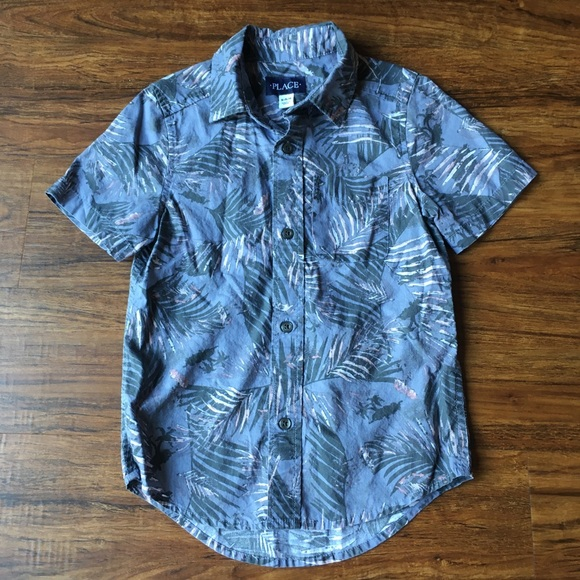 Place button down shirt with palm branches
